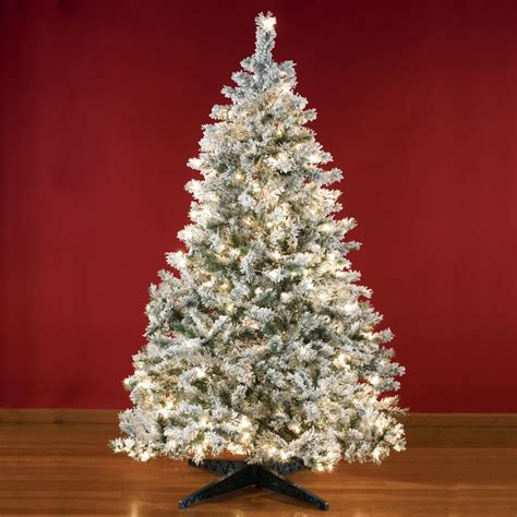 the 8 foot prelit flocked christmas tree hammacher schlemmer