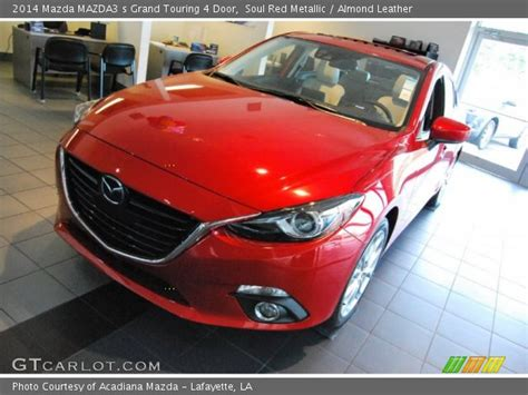 soul red metallic  mazda mazda  grand touring  door almond leather interior