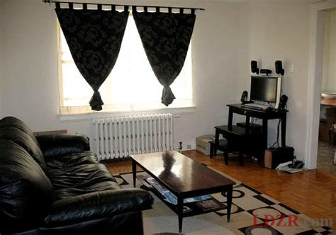 decorating the living room using a black leather sofa
