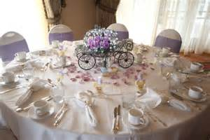struck cinderella carriages as centerpiece for
