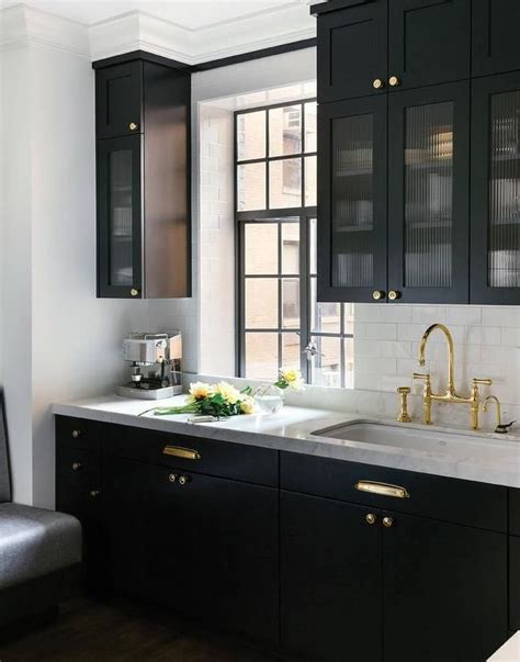 white kitchen cabinets for black kitchen features glass reeded cabinets and 1797