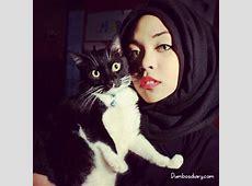 Pretty hijabi girl with cat