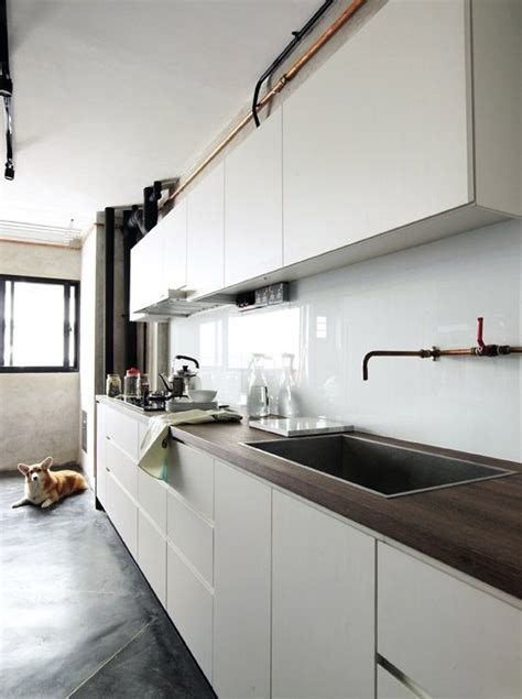 Handle free kitchen cabinets complement the solid white