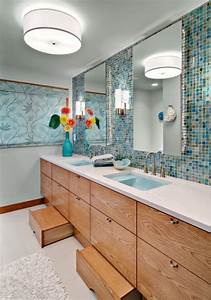 this bathroom features a blue sea like backsplash and With bathroom step stool for toddlers