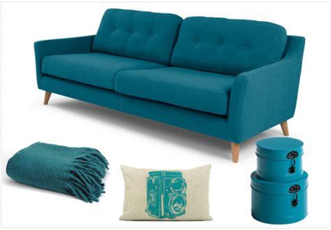 housse de canapé en une touche de bleu canard dans la déco joli place