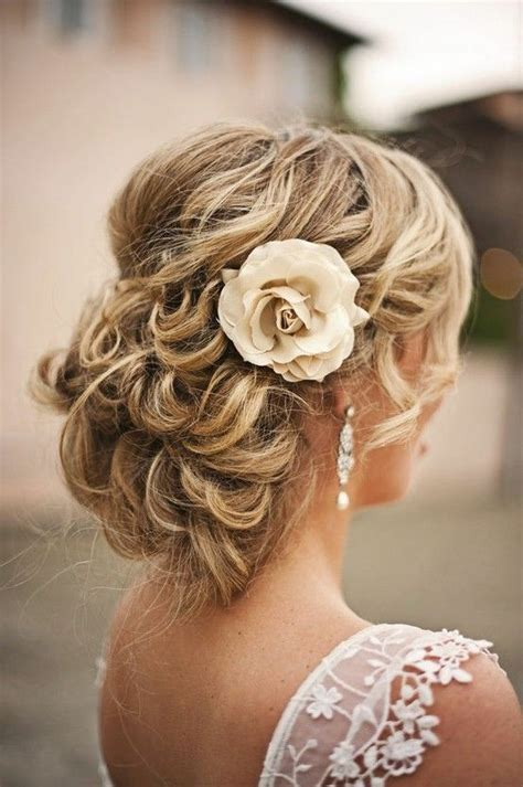 Messy Curly Updo Blonde Flower Pin Up Wedding Bridal Hair