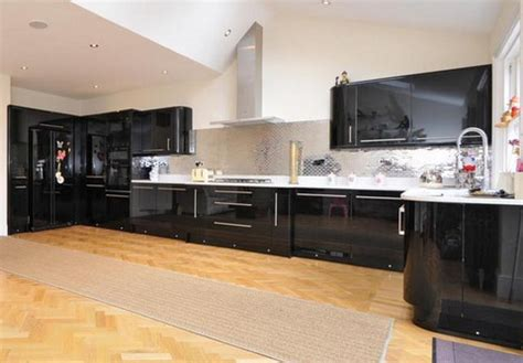 approx yr  black gloss howdens kitchen stone worktops