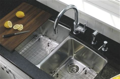 sink protectors for stainless steel sinks stainless steel sink grids and colanders blanco