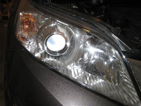 2010 gmc how to change a high beam headlight