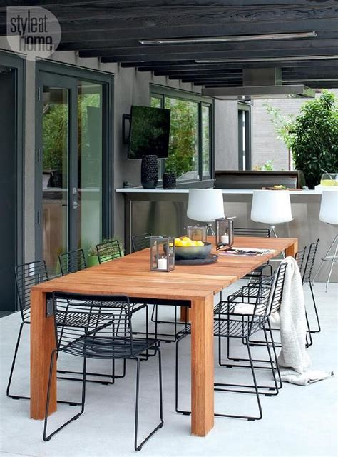 contemporary covered patio  filled   teak dining