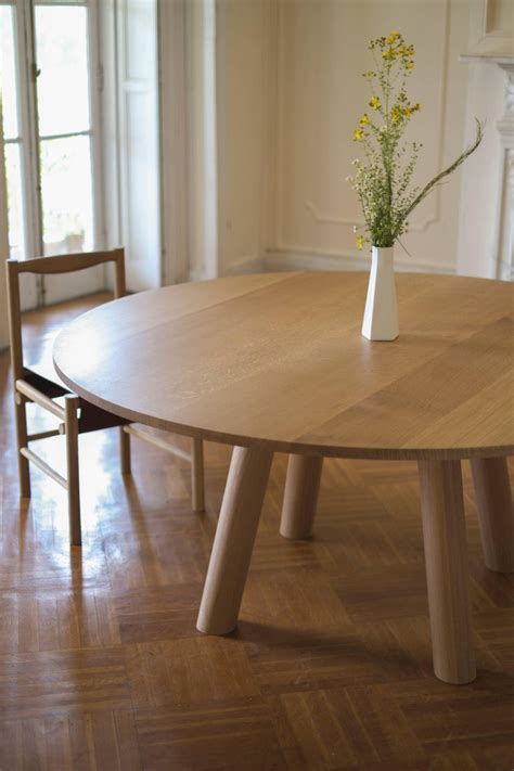 Circular dining tables are space efficient tables designed with a variety of common diameters for specific seating arrangements from small two person tables up to larger twelve person designs. Contemporary Wood Round Column Dining Table in White Oak by Fort Standard For Sale at 1stdibs