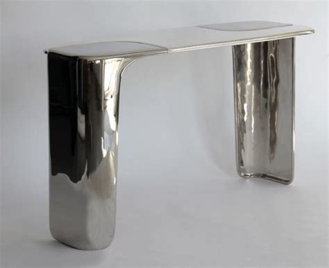 black and silver table ls black and silver patinated console it is a piece of art
