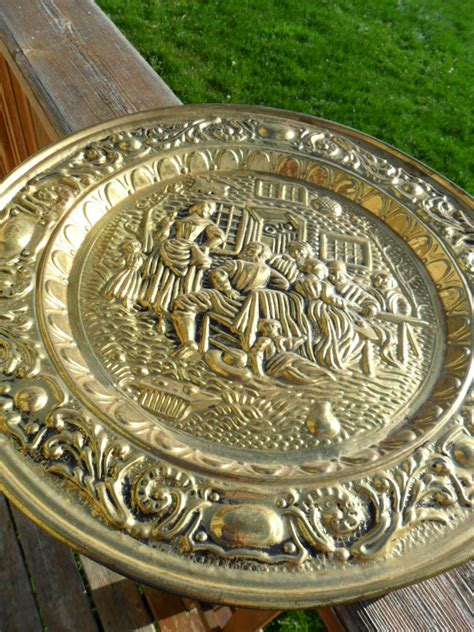vintage brass plate wall hanging   england  kathijanes