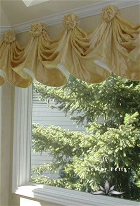 rosette valance  swags hung  rosettes window