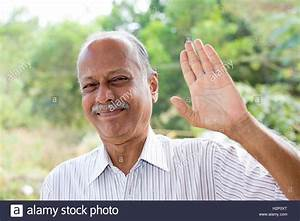Closeup portrait, amiable old man waving hi or farewell ...