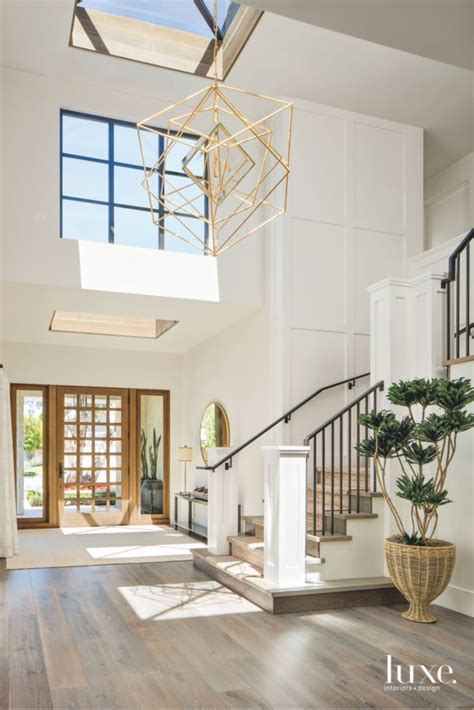 Living Room Entryway Design by Geometric Light Chandelier Entryway With Staircase And