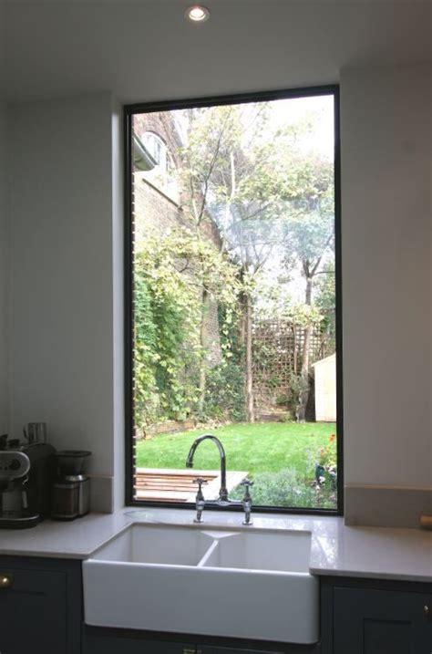 fixed aluminium casement window   kitchen sink  maximise natural light   open plan