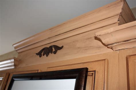 crown molding on top of cabinets transforming home how to add crown molding to kitchen
