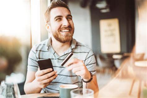 How to use it on your smartphone: Man Using Smartphone And Credit Card For Online Shopping Stock Photo - Image of cash, check ...
