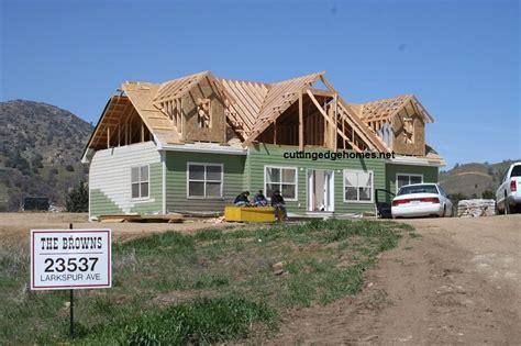 custom-cape-house-in-rough-roof-framing - Modular Homes
