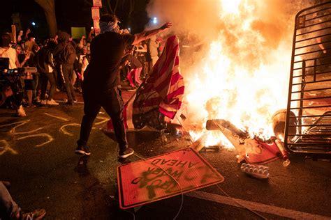 burning george floyd flag protests washington protest dc statues trump