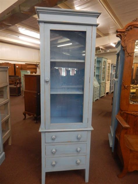 vintage pale blue tall narrow display cabinet  glass