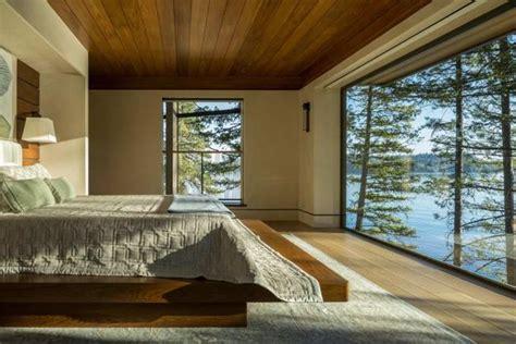 lakefront cliff house design  rocks integrated