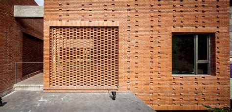 perforated brick screens create private space  busy