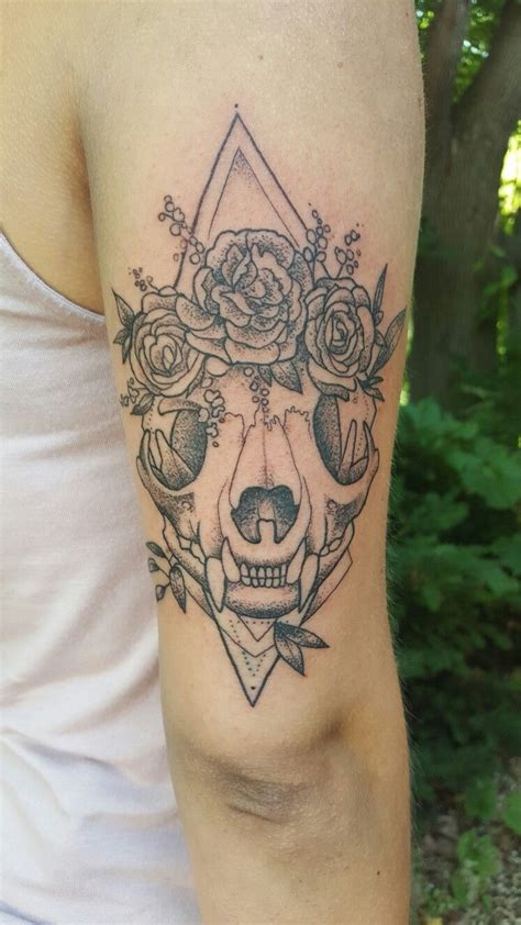 cat skull rocking  flower crown   alex gregory  evolution tattoo minnesota