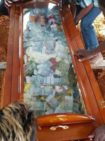 buried  cash    man buried  father  glass