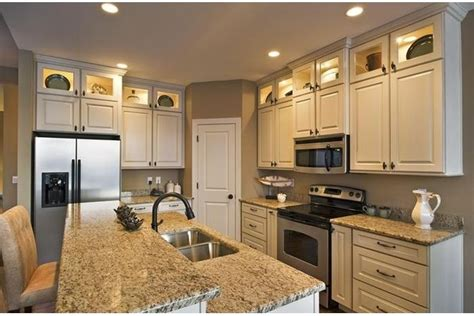 stacked kitchen cabinets   white  grey  home