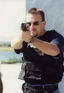 Policeman With Gun photo - Michael Resnik Agent photos at ...
