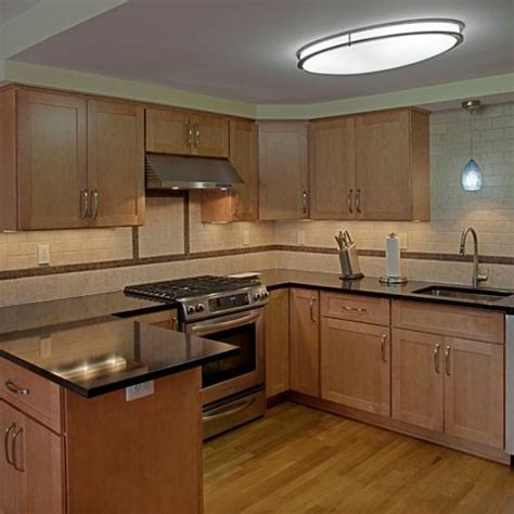 pictures of kitchen light fixtures cambria charston countertops with maple 7466
