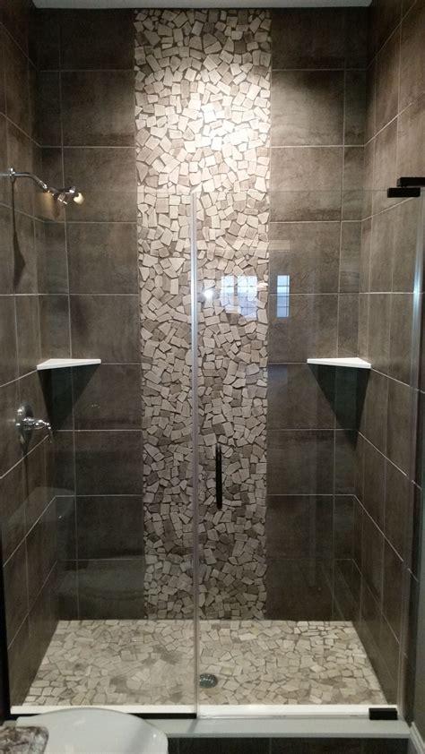 grey shower  pebble tile accents