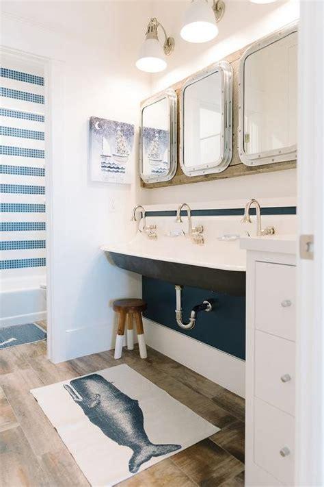 shared kids bathroom  black trough sink cottage
