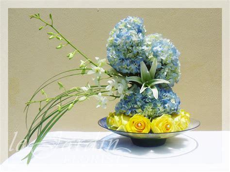 asymmetrical flower arrangement le jardin florist palm