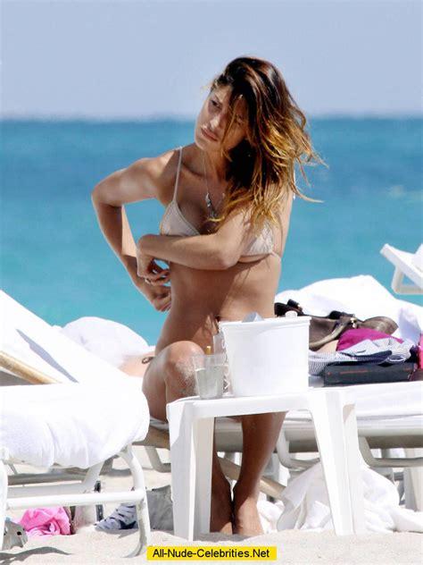 Belen Rodriguez caught topless on the beach