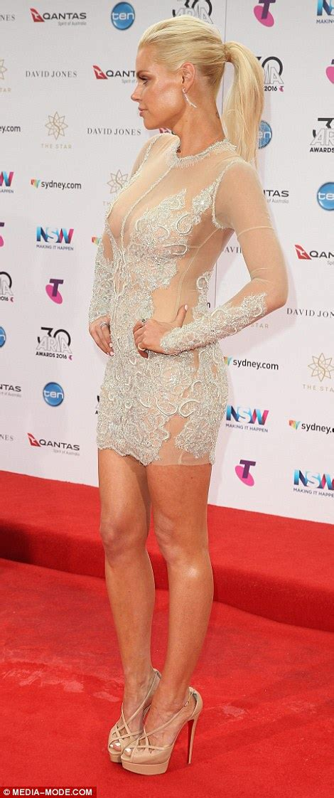 Ksenija Lukich thrills in frills as she arrives on the red