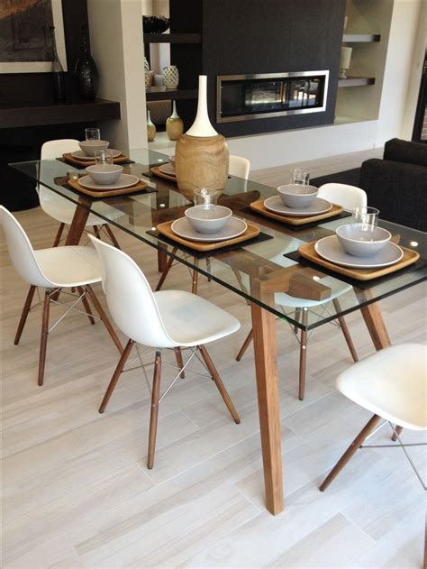 Decorating Ideas For Glass Kitchen Table by Sticotti Glass Dining Table And Eames Dining Chairs In