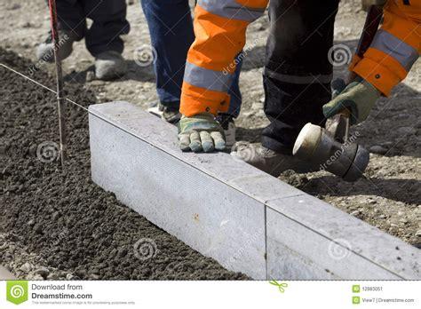 workmen laying granite slabs stock image image 12883051