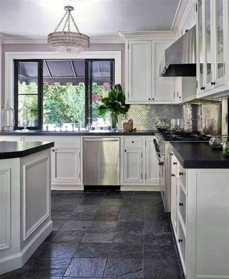 white cabinets grey slate flooring kitchen