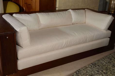 walnut sofa with hidden storage by ilonka karasz at 1stdibs