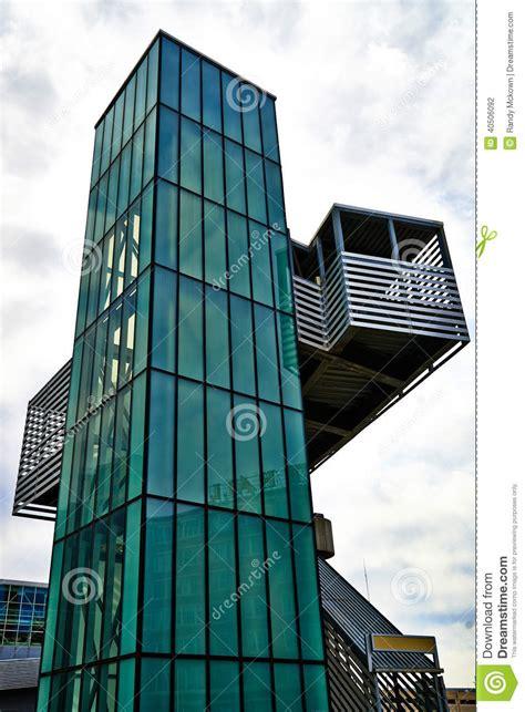 modern architecture green glass elevator stock photo