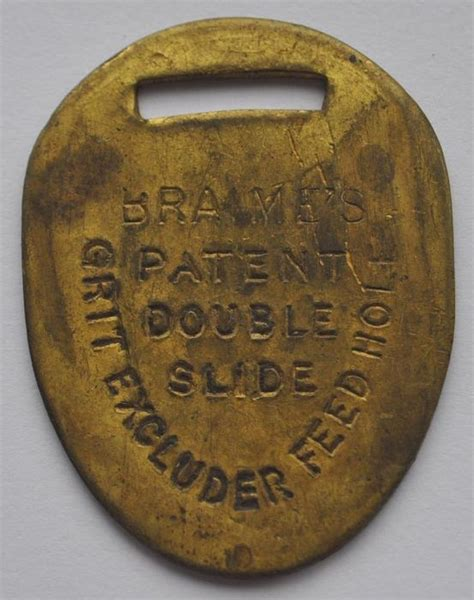 1900s UK Britain Bronze Tag Feed Hole Grit Excluder BRAIME