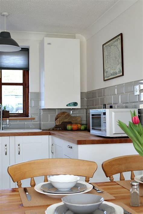 metro tiles in kitchen our country cottage the kitchen white shaker cabinets 7480