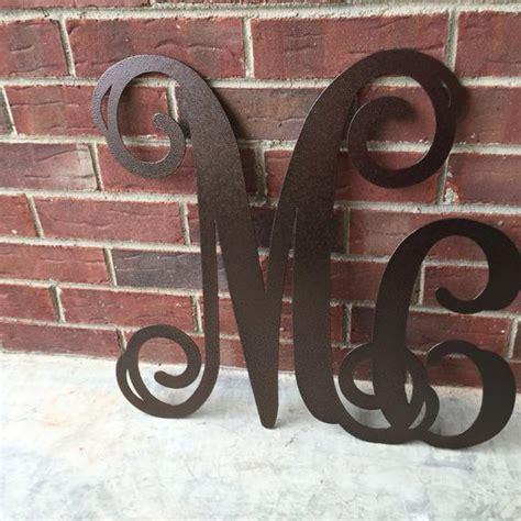 large metal letters mc initial wreath door