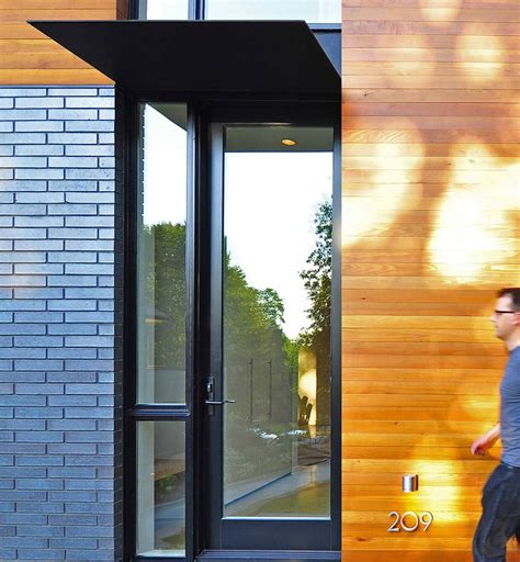 glass front door compact contemporary home in
