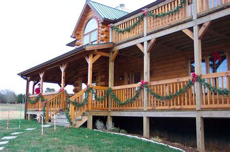log home   exterior decorated  christmas