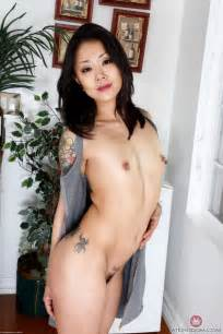 Petite Asian MILF poses at home in nude pictures gallery