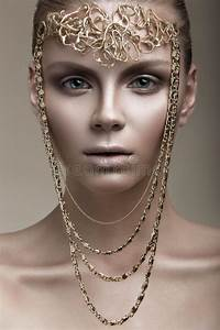 Beautiful Girl With A Bronze Skin, Pale Makeup And Unusual ...